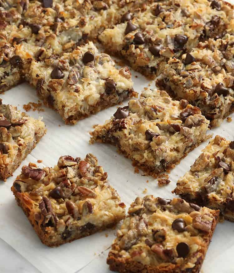 Majic cookie bars on a sheet of white parchment paper.