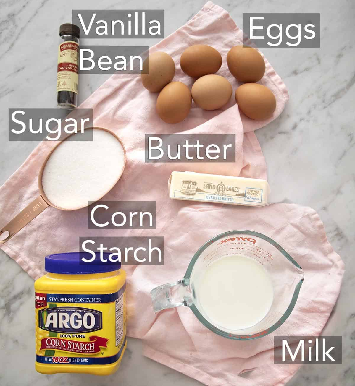Ingredients for making pastry cream on a counter.