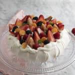 A pavlova on a crystal cake stand