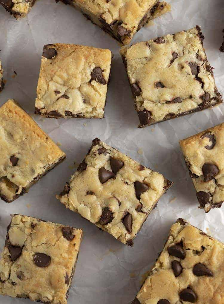 Chocolate Chip Cookie Bars on white parchment paper.