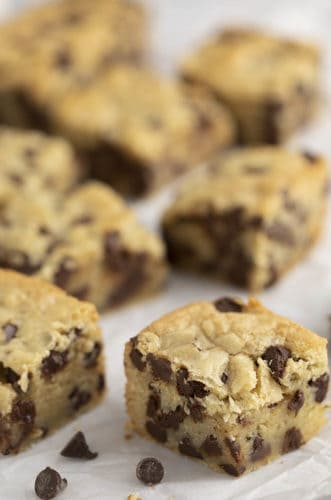 chocolate chip cookie bars on a piece of parchment paper.