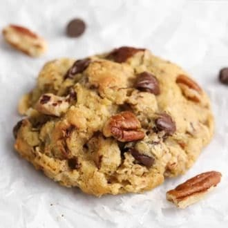 A cowboy cookie with pecans, chocolate chips, oats and shredded coconut.