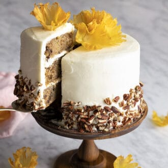 A hummingbir cake topped with pineapple flowers.