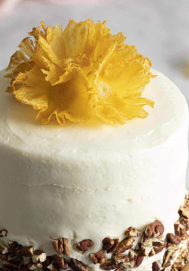 A closeup photo of a hummingbird cake showing the realistic pineapple flowers on top.
