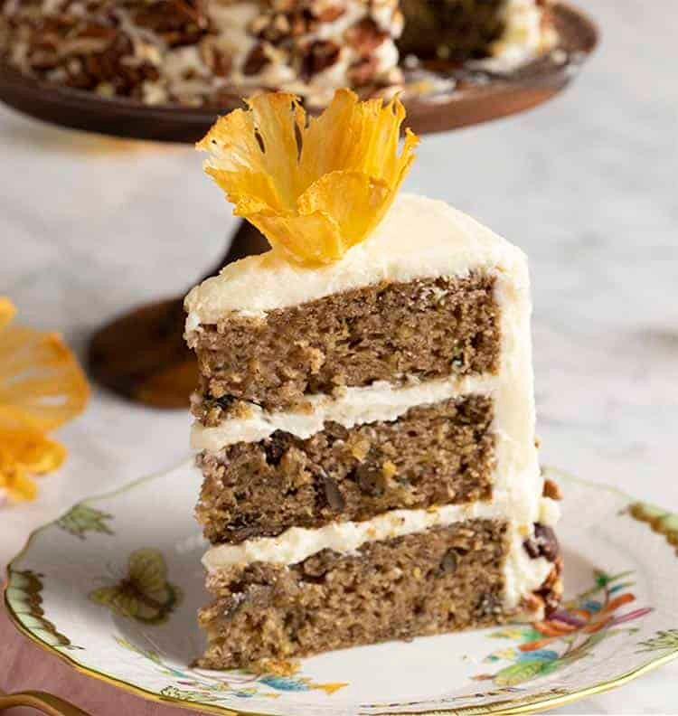 A piece of hummingbird cake topped with a pineapple flower