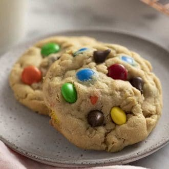two monster cookies on a grey plate.