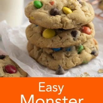 stacked monster cookies on parchment
