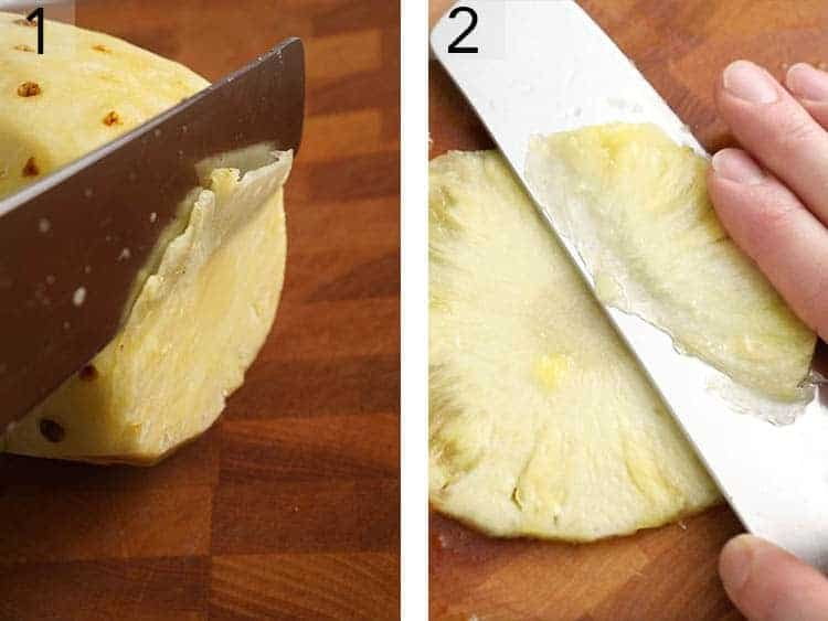 A pineapple getting sliced thinly to make pineapple flowers