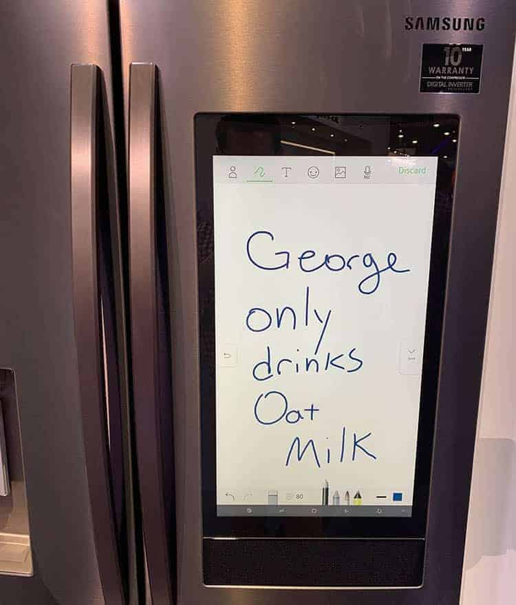 A note written on the screen of a Samsung refrigerator.