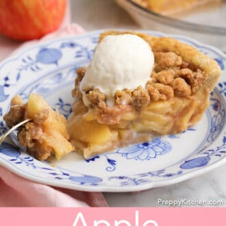 An apple crumble pie on a porcelain plate getting eaten with a golden fork.