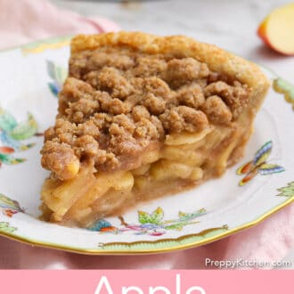 An apple crumble pie on a porcelain plate.