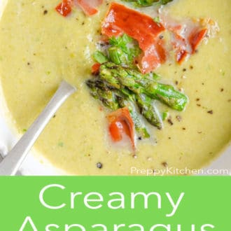 asparagus soup in a white bowl with a spoon