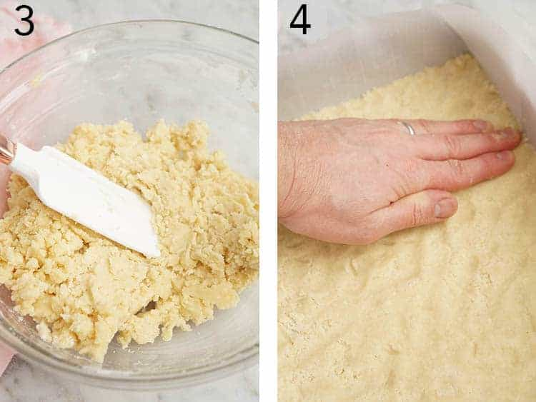 Shortbread crust getting patted into a baking dish.