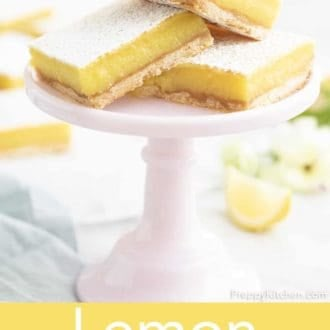 lemon bars stacked on a stand