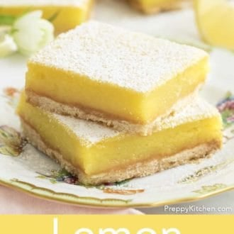 lemon bars stacked on a plate