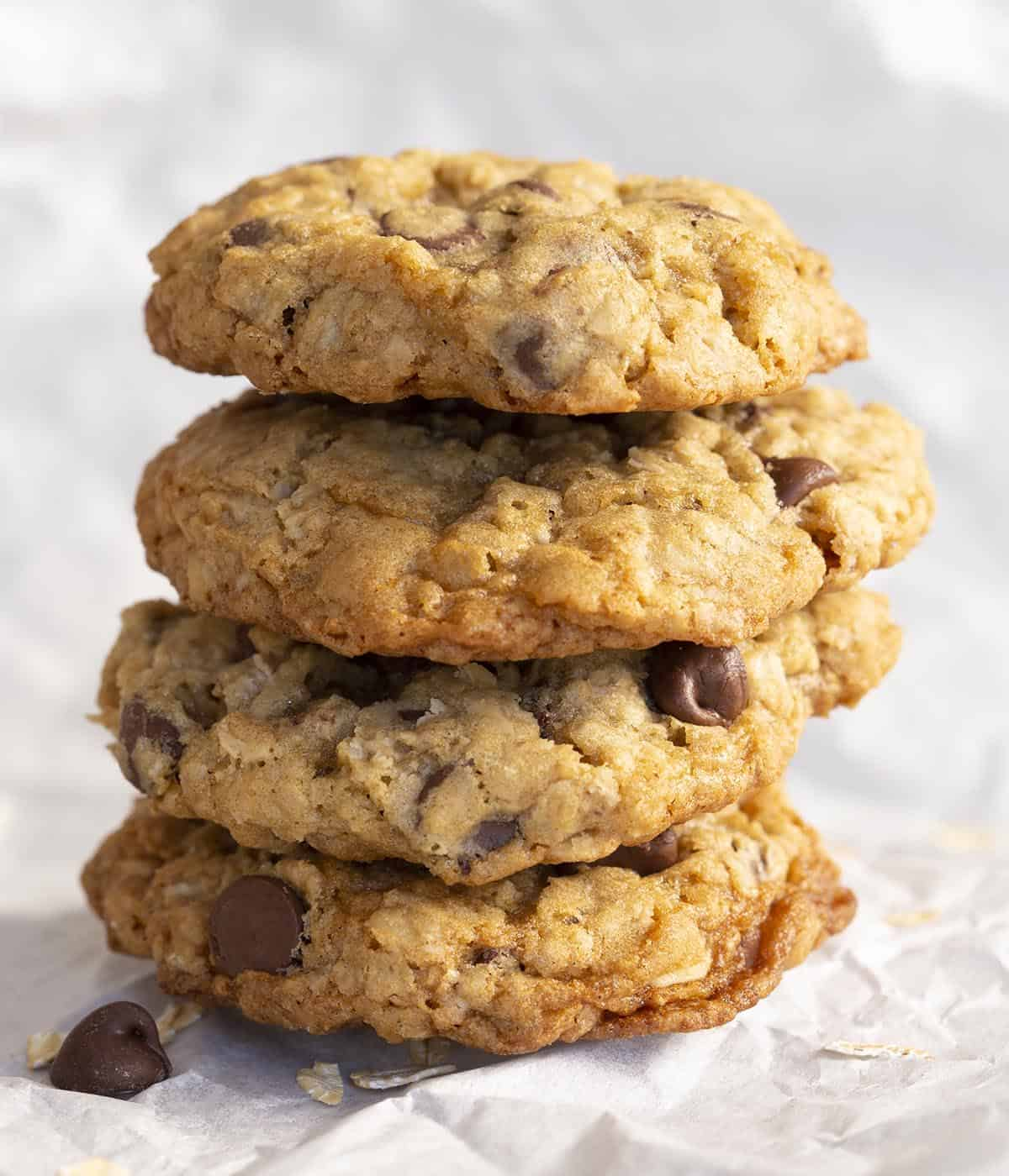 Four Oatmeal Chocolate Chip cookies stacked vertically.