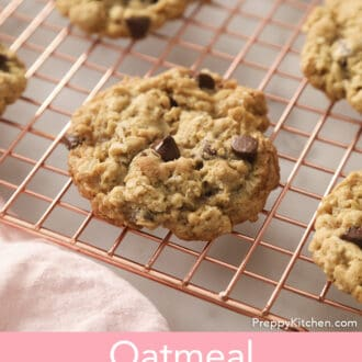 A group of Oatmeal Chocolate Chip Cookies on a copper cooling rack.