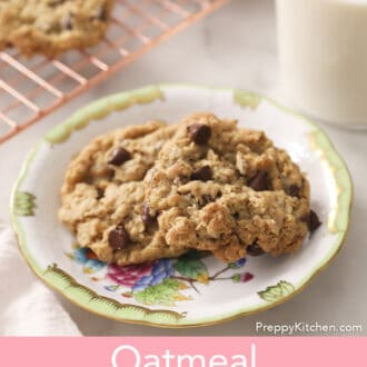 Several Oatmeal Chocolate Chip Cookies next to a glass of milk.