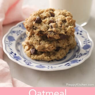 Three Oatmeal Chocolate Chip Cookies on a blue and white plate.