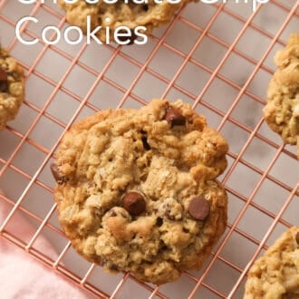 A top-down shot of Oatmeal Chocolate Chip Cookies on a cooling rack.