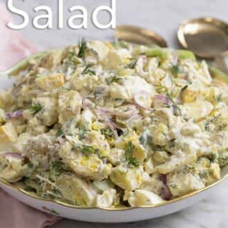 A creamy potato salad next to a pink napkin.