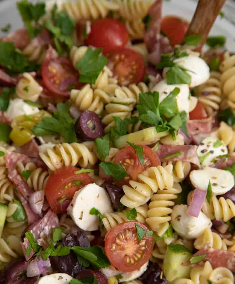 Pasta salad with mozzarella, tomatoes, kalamata olives and fresh herbs.