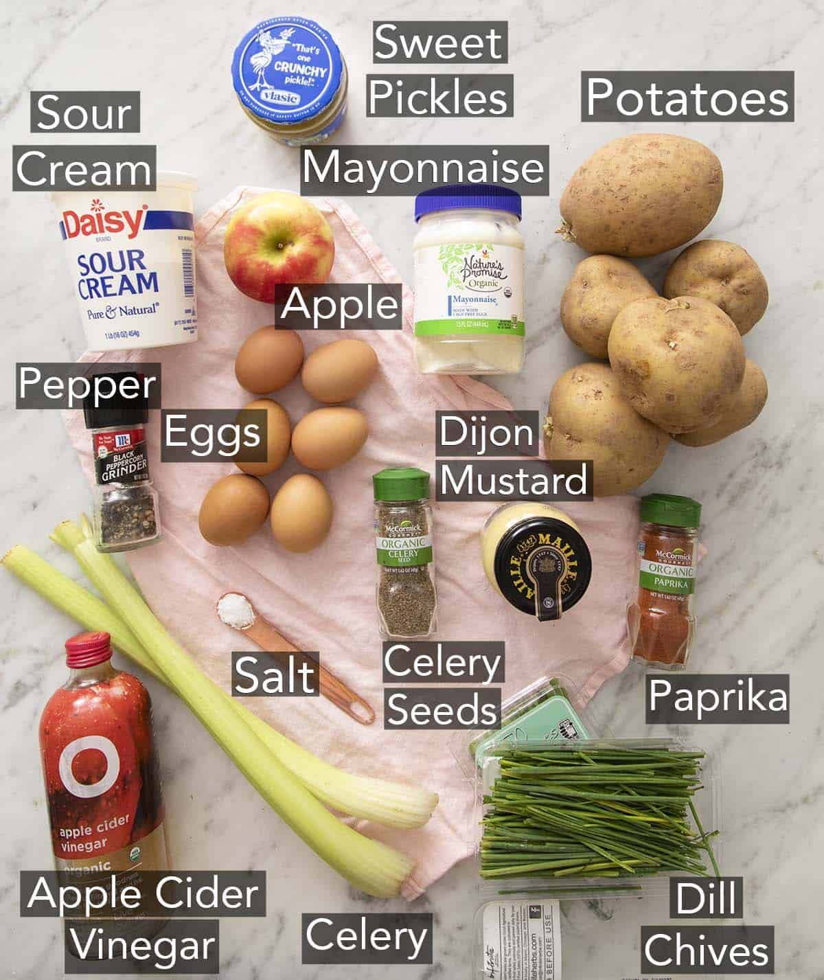Ingredients for making potato salad on a counter.