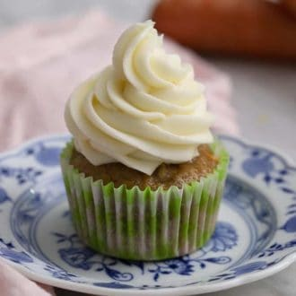 A carrot cake cupcake topped with cream cheese frosting