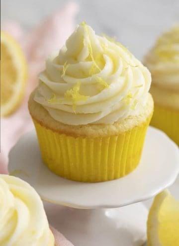 A lemon cupcake topped with a big swirl of lemon buttercream.