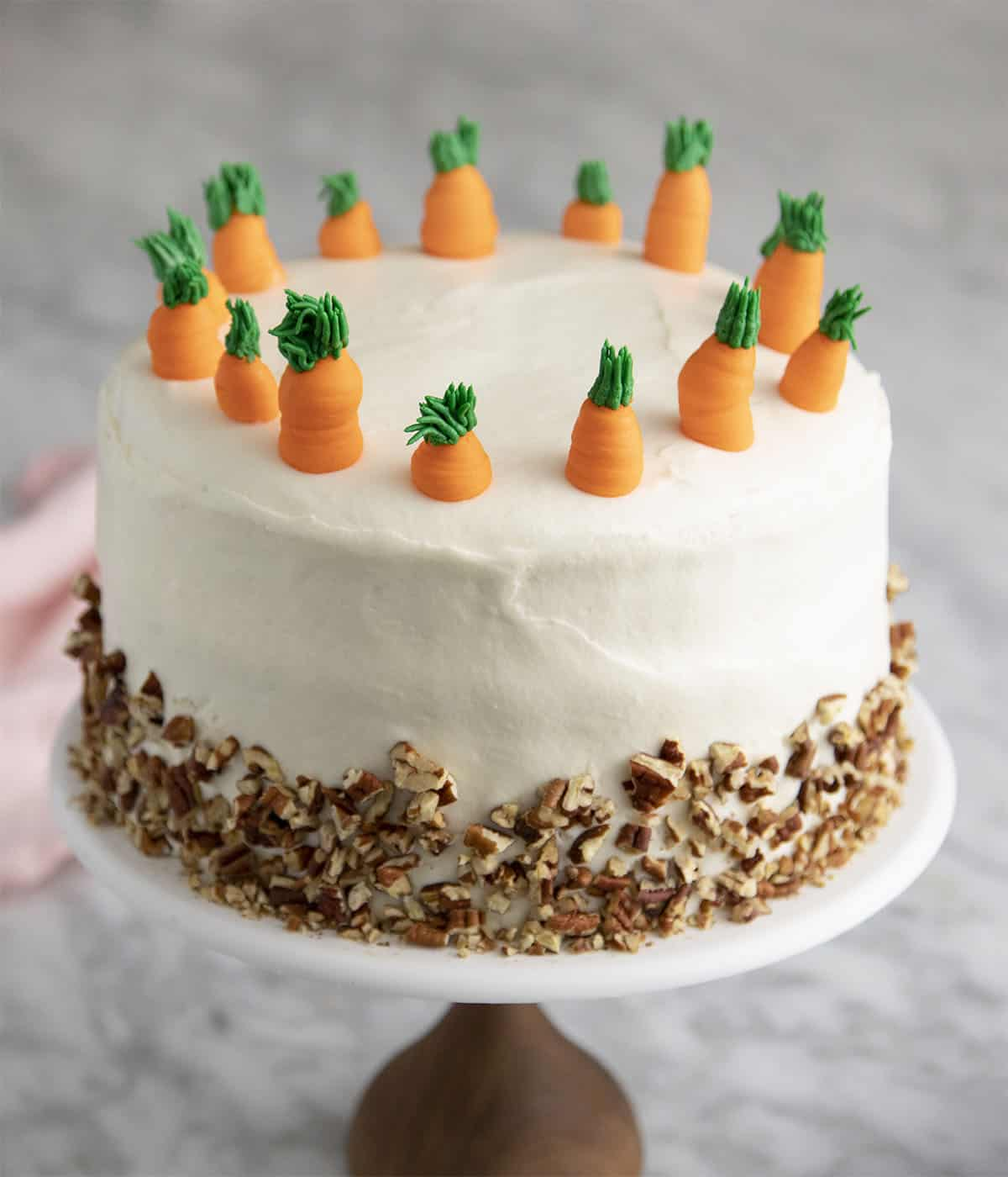 A delicious carrot cake on a white marble table.