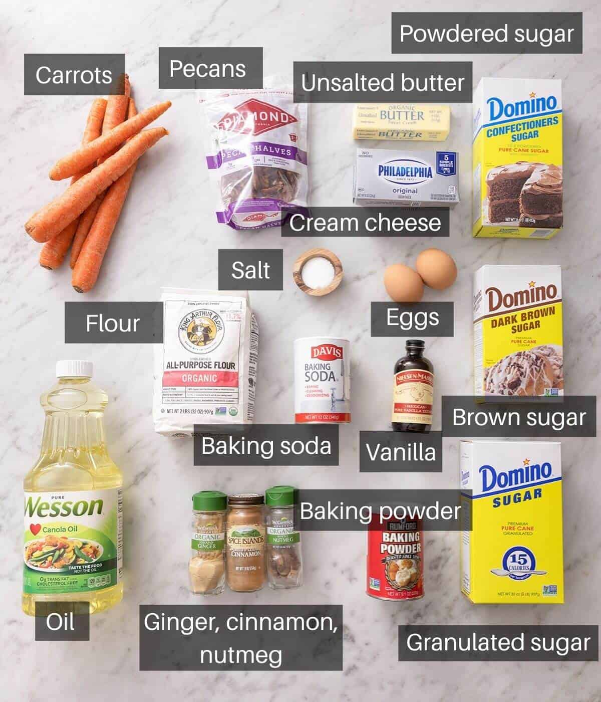 An overhead shot of all the ingredients you need to make carrot cake cupcakes