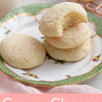 cream cheese cookies stacked on a plate
