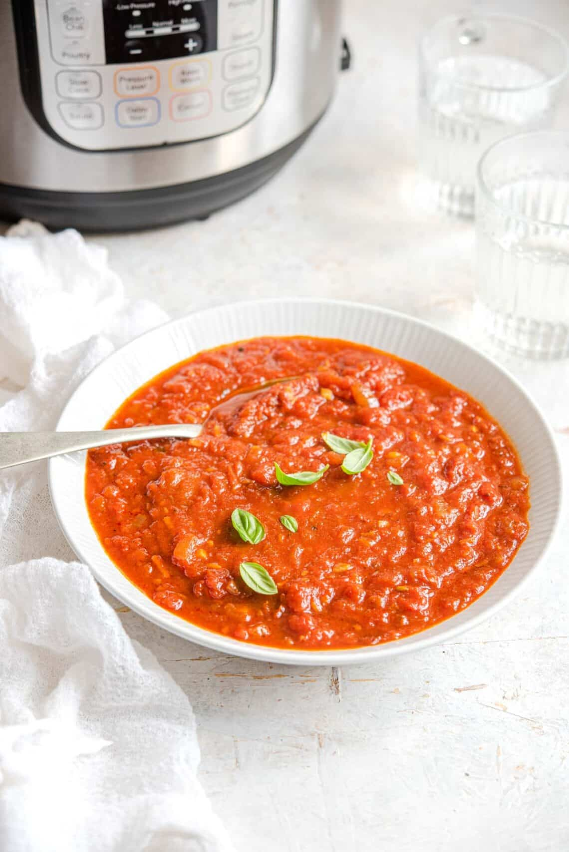 An side shot of spaghetti sauce in a bowl