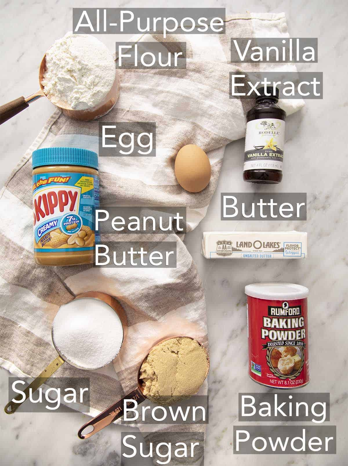 Ingredients for making peanut butter cookies on a counter.