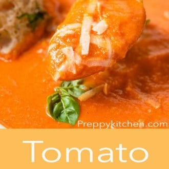 tomato soup in a white bowl with a spoon