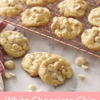 White chocolate chip macadamia nut cookies on a marble counter.