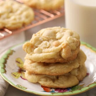 Delicious white chocolate chip macadamia nut cookies on a porcelain plate.