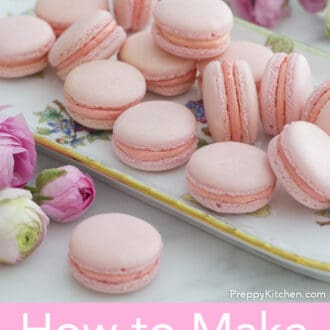 several pink macarons on a tray