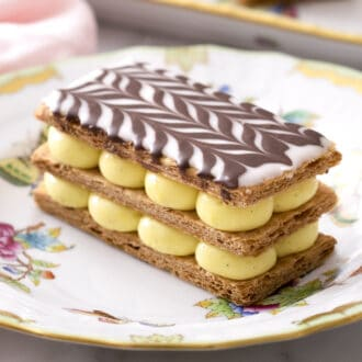 A delicious Mille Feuille topped with a chocolate chevron pattern.