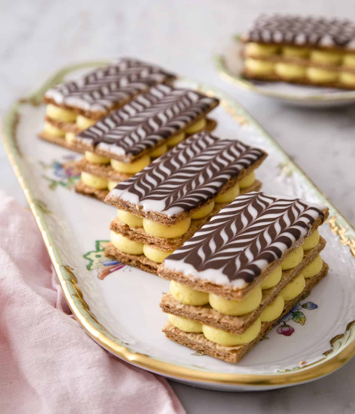 Four Mille Feuille on a serving plate.