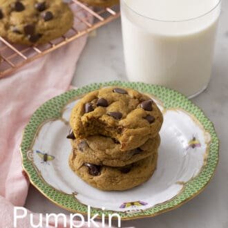 A stack of Pumpkin chocolate chip cookies on a green and white plate.