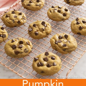 Pumpkin chocolate chip cookies on a copper cooling rack.