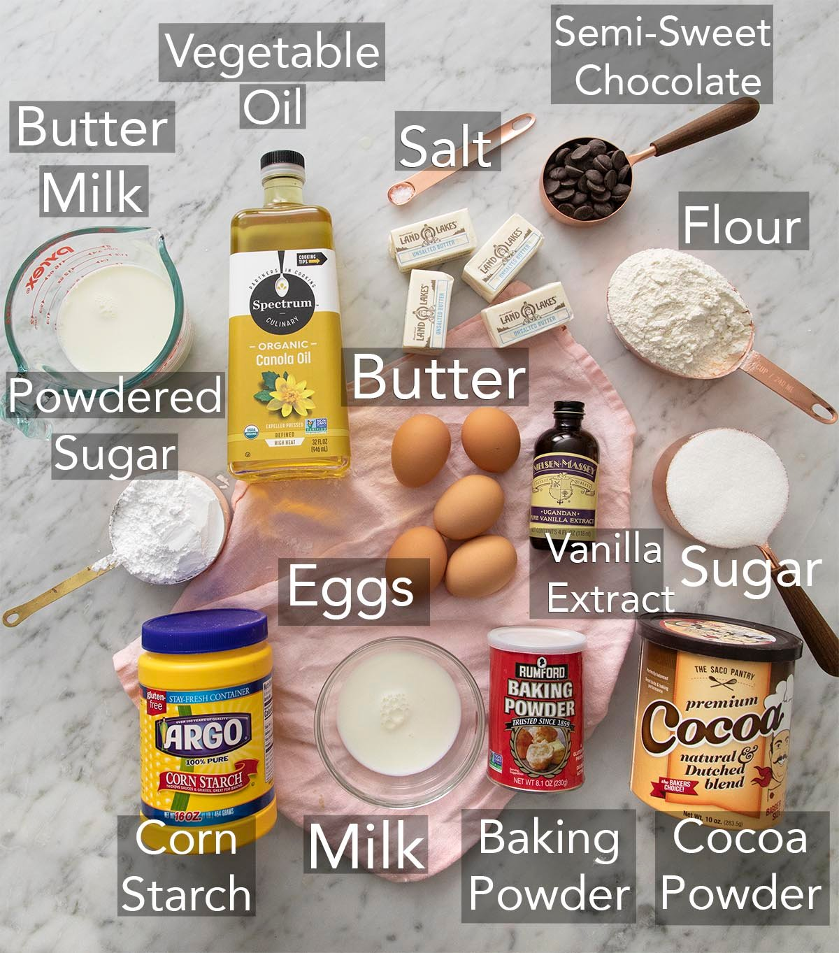 Ingredients for making a Yellow Cake on a counter.