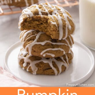 Stacked pumpkin cookies on a plate.