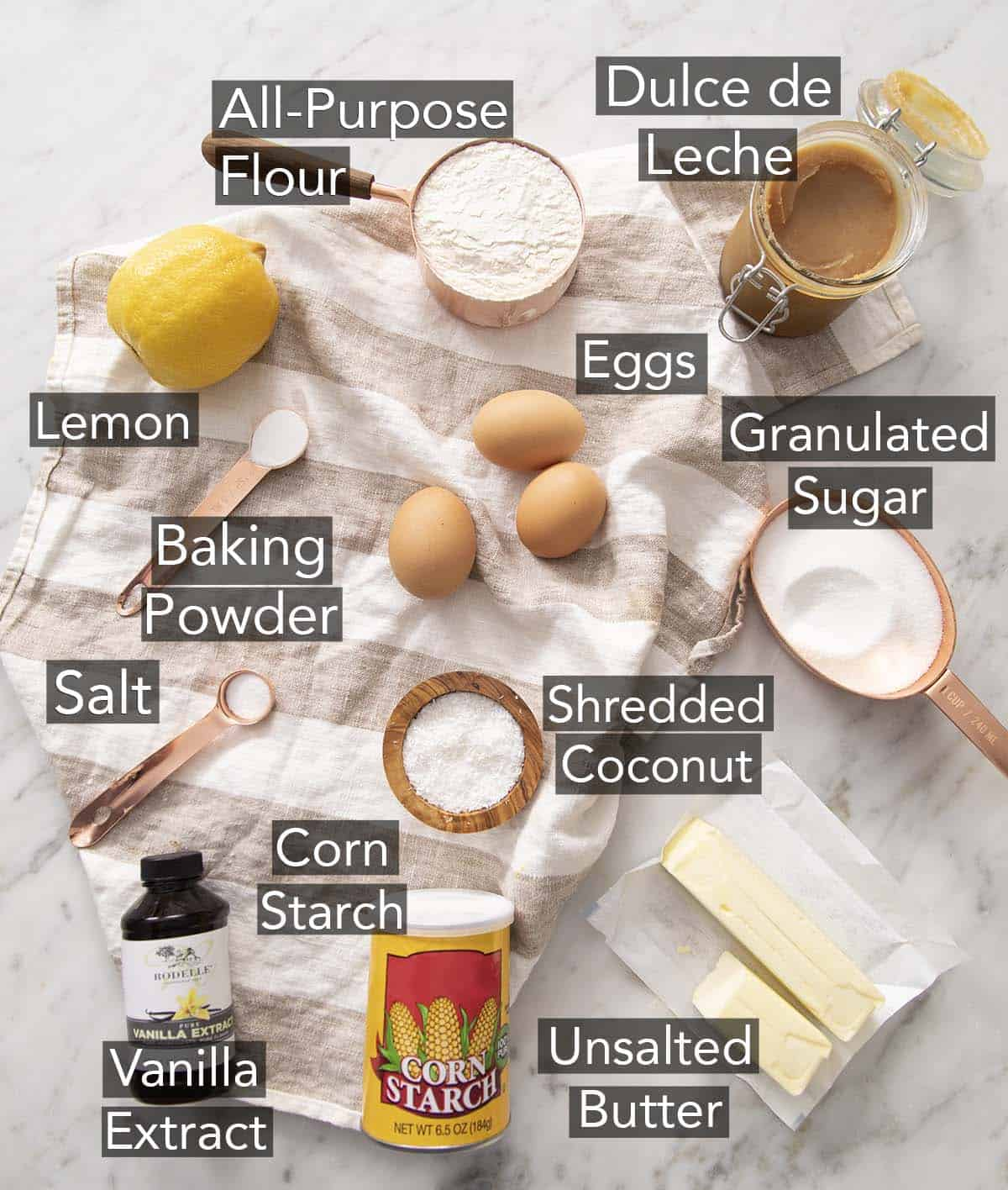 Ingredients for making alfajores on a counter.
