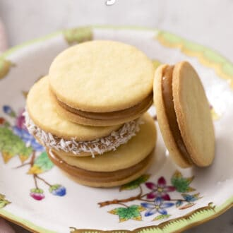 Four alfajores on a porcelain plate.