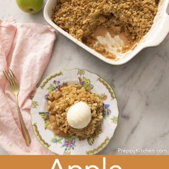A piece of apple crisp on a plate next to some apples.