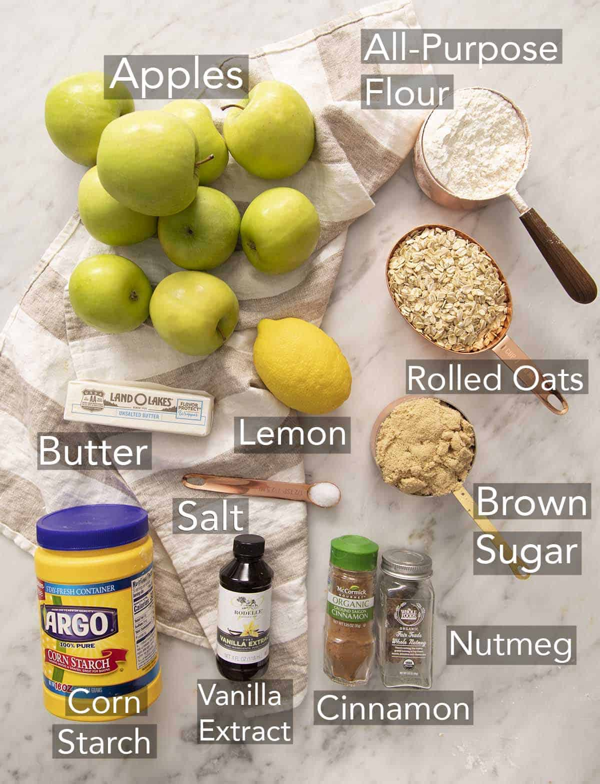 Ingredients for making apple crisp on a counter.