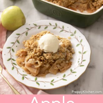 An apple crisp on a plate with painted leaves.