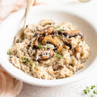 A square image of mushroom risotto in a bowl